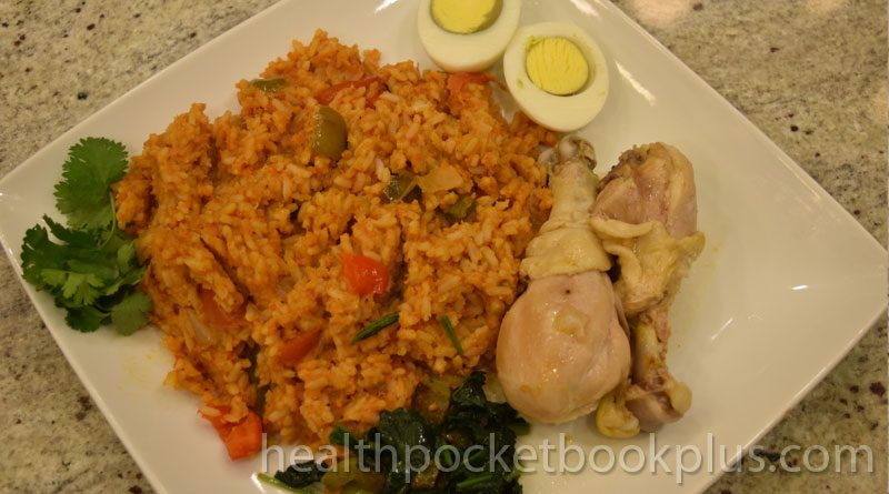 jollof rice with chicken boiled eggs and spinach